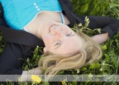 {Emily} (Farmgirl18) Tags: blue summer girl grass canon 50mm dress jacket blond l 12 relaxed sundress dandelions laying porait