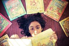 F   G   H   I   J (Proleshi) Tags: light 50mm reading book arthur kid warm child bokeh naturallight read josephs jamal fghij d300s proleshi