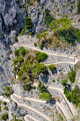 Capri island, famous road Via Krupp on the mountains,Italy (Dragos Cosmin- Getty Images Artist) Tags: ocean road street travel cruise blue sea summer sky italy white mountain holiday plant color tree green beach nature water beautiful beauty rock stone landscape island capri bay coast italian ramp colorful europa europe mediterranean campania view path turquoise south via countries human naples coastline curve vacations turning twisty krupp
