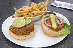 Crab Cake Burger with French Fries (JPLPhotographyPDX) Tags: food white fish hot chicken face cake cheese tomato french bread table lunch restaurant open place napkin knife salmon crab fork bowl bistro meat lettuce fries slice buns meal seafood onion lime melted cod pickle fishcake halibut crabcake battered deepfried