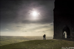 Figures on the Tor (zolaczakl) Tags: uk england landscape countryside glastonbury somerset figure tor afternoonsun glastonburytor somersetlevels stmichaelstower nikond7100 photographybyjeremyfennell