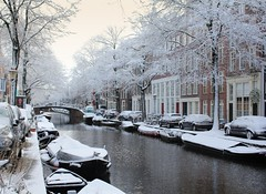 Amsterdam covered in a coat of fresh snow (Bn) Tags: world street trees windows winter light sunset people sun seagulls house snow cold holland heritage church water netherlands dutch amsterdam weather bike corner walking frank anne 1 boat canal cozy cool colorful shadows snowy walk seagull sneeuw bikes atmosphere scooter file topf300 canals unesco then brug now snowfall sled mokum rembrandt meeuw topf200 meeuwen gezellig cafs jordaan eerste sleding slee bycicle pakhuis westerkerk wester bloemgracht c celcius grachtengordel rondvaartboot 1000km raampoort 200faves 300faves lekkersluis bloemdwarsstraat