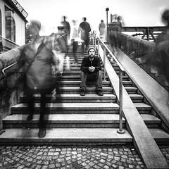 Solitude (RuinOfDecay!) Tags: people bw white man black stairs contrast germany bayern deutschland bavaria sadness 1 long exposure solitude sitting sad time second sw mann passing regensburg philipp einsamkeit schwarz 1x1 treppen langzeitbelichtung vanish sitzen trauer passangers weis gedanken passanten ratisbona schweinitz throughts 1018mm canoneos60d amesoeurs ruinofdecay ratisbonn