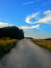 Abeline TX (Rachel Jean Photography) Tags: road blue trees sky tree nature grass clouds landscape texas country dirt land hay gravel
