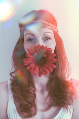(emma Barnfield) Tags: camera light red portrait people flower love me photography ginger photo rainbow eyes nikon mood peace photographer bright naturallight indoor redhead lightleaks ourworld hippie freckles boho meaning flowerpower makelovenotwar portraitwithflowers