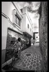 Al trabajo en bici (meggiecaminos) Tags: street bw white black men muro blanco bike bicycle wall buildings calle edificios strada negro streetphotography bicicleta bn morocco bici marocco marruecos bianco nero muralla urbanlandscape hombres palazzi bicicletta asilah uomini fotografaurbana