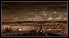 dark skies en route to Santa Fe (milomingo) Tags: road light shadow sky cloud newmexico southwest texture monochrome weather sepia dark landscape highway desert outdoor grain monochromatic frame arid photoborder