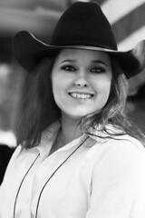 Cowgirl Rides (wyojones) Tags: houstonlivestockandrodeoparade texas houston houstonlivestockshowandrodeo parade trailride cowgirl girl woman beauty beautiful pretty cute lovely redhead hat cowgirlhat cowboyhat blackandwhite bw grayscale portrait outdoor wyojones