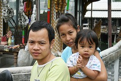 family on a motorcycle (the foreign photographer - ) Tags: family portrait cute portraits canon mouth thailand kiss shrine child braces bangkok father mother jewelry motorcycle khlong bangkhen thanon 400d