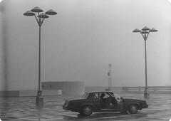 IMG_0028 (niiicedave) Tags: california fog oldpictures sanjoaquinvalley wetpavement communicationstower blackandwhitephoto emptyparkinglot parkinggaragerooftop parkinglotlamps fresnocityincaliforniausa