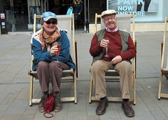 Free Prosecco (john atte kiln) Tags: couple oldcouple manwoman womanman husbandwife wifehusband drink deckchairs celebrating celebration prosecco glasses plasticglasses hats waistcoat scarf shoes happy relaxed spectacles