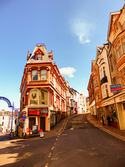High Street, Ilfracombe, North Devon (photphobia) Tags: road uk houses sky holiday building architecture buildings hotel vanishingpoint seaside outdoor perspective victorian shops ilfracombe northdevon victorianterrace oldwivestale victorianresort buildingsarebeautiful