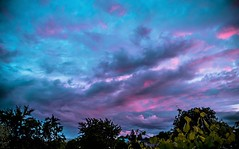 Purple clouds at sunset (Vlad S. Ionita) Tags: life pink blue autumn trees sunset red summer sky orange cloud brown sun sunlight plant storm abstract hot reflection building green art ice nature leaves rain silhouette set night clouds dark out skyscape spectacular landscape outside fire photography dawn evening eclipse leaf vineyard high saturated vines colorful day skies seasons purple spectrum natural artistic cloudy outdoor dusk smoke horizon low perspective fluffy atmosphere vine windy foliage formation blocked burning grapes serene curve grape penumbra