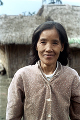 32-249 (ndpa / s. lundeen, archivist) Tags: rural village people nick dewolf nickdewolf 32 reel32 color photographbynickdewolf 1970s 1972 fall film 35mm winter republicofchina taiwan taiwanese eastcoast easterntaiwan hualien hualiencounty easterncoast rurallife unidentified woman face portrait building house home thatchroof thatchedroof china chinese 1973