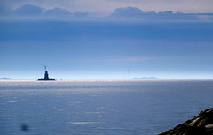 Morning mist at Oresund (Ivan Naurholm. thanks, for more than 500.000 views) Tags: copenhagen denmark oresund resund drogden lighthouse fyr malmo turning mist blue morning torso beautiful tranquillity peaceful quiet nice cloudscape island fyrtrn  saltholm malm malm sweden