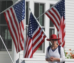 Lady in the red hat (stephencharlesjames) Tags: red hat lady bristol stars vermont day stripes july flags independence fourth