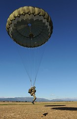 British Paratrooper Landing During Exercise (Defence Images) Tags: uk soldier army spain military free drop landing british defense defence zone parachute personnel paras paratrooper zaragosa labandera theparachuteregiment 3para nonidentifiable 3rdbntheparachuteregiment thelightdivisionlight 3rdbattaliontheparachuteregiment3para exiberianeagle