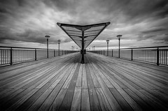Walk the Boards (Scott Baldock) Tags: sea england blackandwhite bw storm art beach architecture clouds point pier vanishingpoint seaside nikon angle wide dorset vanishing bournemouth boscombe d7000