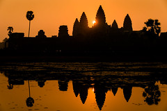 Spectacular clean sunrise at Angkor Wat Cambodia. (apertureDC) Tags: world old travel sky sun lake flower reflection building tree tower heritage tourism monument up rock stone architecture sunrise asian religious temple gold site ancient colorful asia cambodia khmer exterior lotus decorative buddha background religion tomb ruin buddhism unesco siem reap tropical thom angkor wat hinduism vacations raider worldancient