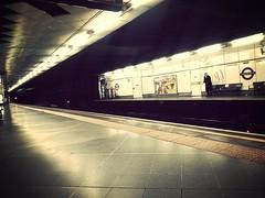 Alone on the underground (derena_d. (Thanks for 1+ Million Views)) Tags: london smart station underground subway alone tube platform suit solo embankment gentleman maninblack overcoat flickrandroidapp:filter=mammoth