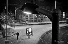 Snow Walker (Sven Loach) Tags: road street uk winter england bw man cold london ice lamp night walking advertising evening nikon noir britain streetphotography rails bleak snowing poles hackney streaks eastlondon sleet morninglane d5100