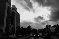 One rainy evening.. (Parthasarathy.S.K) Tags: blackandwhite india rain canon photography monsoon chennai rainyseason indianstreet incredibleindia chennaiindia chennairains canoneos1100d