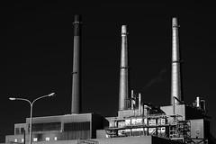 Stacks in the sun (rexp2) Tags: industry smokestack powerplant bwblackandwhitebw nikkor100300mmf56ais alienskinexposure5 sonyalpha7rilce7ra7r