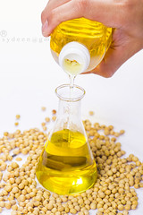 pouring yellow soya bean oil (sydeen) Tags: test food glass yellow bottle healthy raw hand tube cook seed indoor bean whitebackground oil translucent oily soya liquid glassjar pouring ingredient uncooked soyabeanoil noneatable