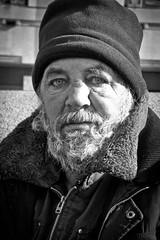 Homeless: Jurak (Daria Angeli) Tags: urban bw man paris france face hat beard expression homeless streetphotography polish february parigi 2014 garedulyon jurak leagueofwomenphotographers