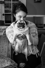 Lucie with Pug (Gene Fama) Tags: birthday dog monochrome pug lucie sundaydinner leicasummiluxm50mmf14asph mereshouse leicasf58flash leicamtyp240