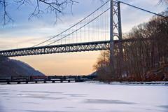 Crossing Frozen Popolopen Creek (SunnyDazzled) Tags: railroad trestle bridge winter sunset snow ice creek train river frozen scene bearmountain covered hudson freight fortmontgomery popolopen