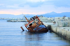 Faliro Athens - Poseidon's  wreck early in the morning (spicros78) Tags: morning sea graffiti athens greece wreck poseidon faliro canon702004l canon50d