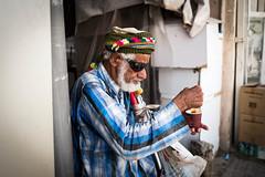 Karak Time (Robber34) Tags: street leica old people color tea streetphotography oldman grandpa q doha qatar karak leicaq