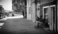Shaded Outside No 50 (Just Ard) Tags: street venice boy people blackandwhite bw blancoynegro girl monochrome bench person photography mono nikon sitting noiretblanc zwartwit candid 85mm shade d750 unposed  biancoenero burano schwarzundweis justard