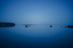 Fading Blue (trm42) Tags: morning blue sea nature suomi finland island spring helsinki rocks fade serene vignetting meri lauttasaari beforesunrise kevt aamu