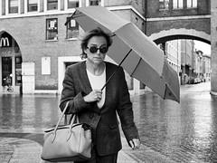 . (alb.montagna) Tags: street portrait people blackandwhite bw italy monochrome rain umbrella streetphotography streetportrait zuiko olympusomdem10mkii