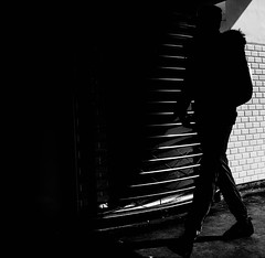 Into the Dark (Dan-Schneider) Tags: street camera trip travel light shadow people urban blackandwhite bw paris silhouette photography prime europe streetphotography olympus scene best moment schwarzweiss decisive schneider momochrome mft einfarbig omdem10