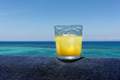 Anyone fancy a rum sour? (Bendigoish) Tags: blue sky orange sun yellow towel rum sour