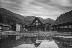 Ancient ([~Bryan~]) Tags: ancient housing houses reflection ndfilter time architecture japan shirakawago daytimelongexposure longexposure water old cloudmovement