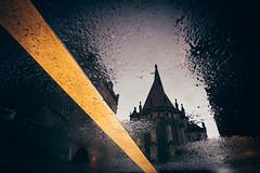 Backside Lamberti Church Mnster Germany (Mugelone) Tags: mnster lambertikirche church puddle pftze spiegelung reflection reflektion reflexprojekt reflex sonya7r zeissloxia2821 yellow road mark asphalt
