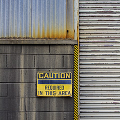 Indeed, caution required... (MyArtistSoul) Tags: ventura ca juniperthompson abandoned building exterior wall brick corrugated galvanized steel metal caution sign yellow black orange red rust textures patterns lines rectilinear minimal abstract urban square 0435 fromseriesawaitingpintoftuxattopatopa