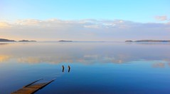 Happy Midsummer! (sakarip) Tags: blue sea sky reflection water clouds finland island evening still midsummer calm memory serene meri juhannus gulfoffinland kotka hamina suomenlahti tyyni thewateriswide vuorisaari sakarip
