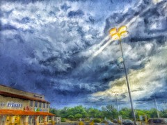 in the eyemart of the storm (Pejasar) Tags: shockpfthenew clouds storm eyemart blue orange weather tulsa oklahoma parkinglot lights lamps paint texture