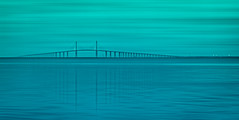 Lost in Reverie (justenoughfocus) Tags: longexposure bridge seascape monochrome unitedstates florida fineart minimalism palmetto sunshineskyway dreamscape paintography emersonpoint sunshineskywaybridge manateecounty sonyalpha sonya7r2