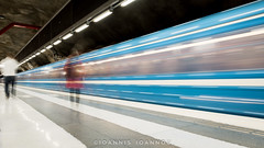 Duvbo Metro Station in Stockholm, Sweden (Ioannis Ioannou Photography) Tags: lights metro blur waiting fluorescent ioannisioannouphotography travel passengers train reflections sweden stockholm scandinavia longexposure station duvbo subway sverige tbana