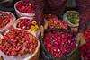 Flower seller (mindweld) Tags: roses mysore flowerseller floweryshirt devarajamarket devarajursmarket