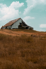 Desolate (Stacey Shay) Tags: travel sky nature field grass clouds barn rural landscape nikon farm rustic 85mm missouri missouriphotography staceythompsonphotography