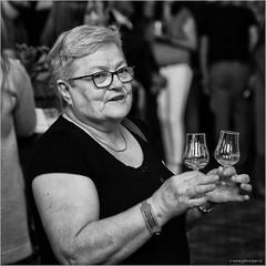It takes two to tango (John Riper) Tags: street two portrait bw white black netherlands monochrome lady canon john square photography mono glasses zwartwit candid event drinks l gin cultural schiedam 6d 24105 genever jenever straatfotografie gincity riper johnriper jeneverfestival