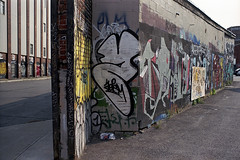 Untitled (Armin Schuhmann) Tags: 2003 street old city urban bw canada color film wall analog 35mm vintage lens prime graffiti haze focus paint cityscape fuji dof asahi takumar quebec bokeh drawing superia decay montreal uv cement wideangle super ishootfilm scan negative filter m42 radioactive pelicula f2 analogue manual filme expired fujica st705 100asa argentique filmscan analogic selfdeveloped screwmount supertakumar c41 filmphotography 2015 griffintown unicolor lanthanum shootfilm filmphoto filmisnotdead thorium analogo believeinfilm buyfilmnotmegapixels