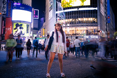 Girl standing still at Shibuya Crossing (Apricot Cafe) Tags: portrait woman girl japan night standing private walking tokyo outdoor shibuya happiness indoor headphones youngadult enjoying oneperson shibuyacrossing canonef1635mmf28liiusm img640597